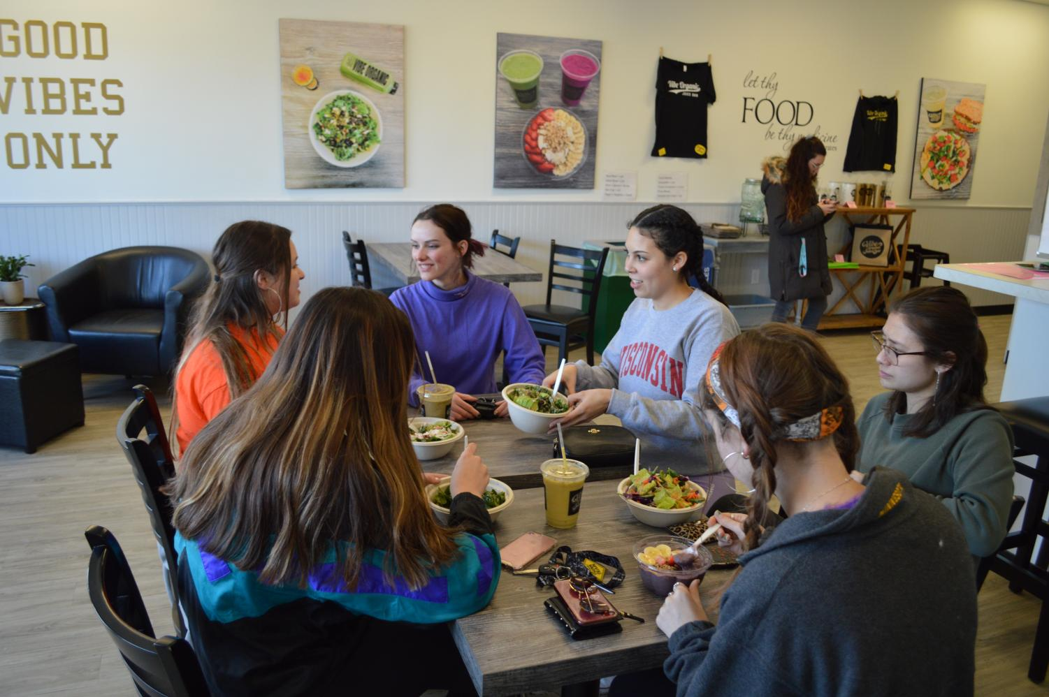 Senior Vegan Club president Lara Garcia speaks to senior members Cecelia Brown and Bryn O'Gara during their meeting at Vibe Organic Juice Bar March 6. According to Garcia, it was the final meeting of the year.