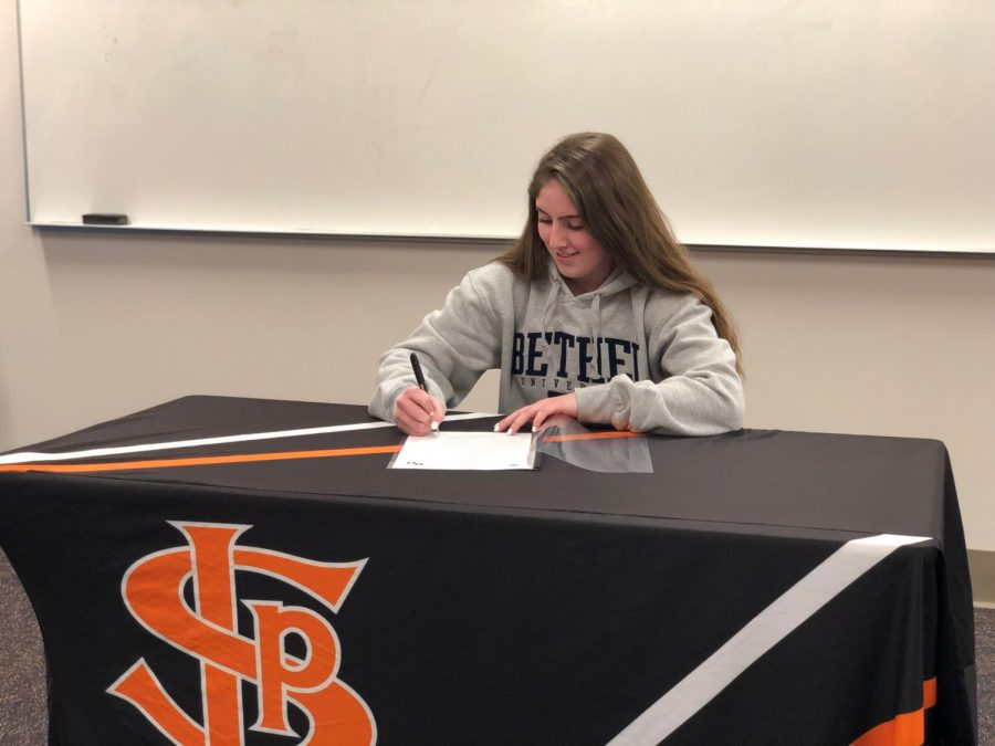 Senior Savannah Romero signs her commitment to play softball at Bethel University. Romero was accompanied by her coaches, friends and family while she signed.