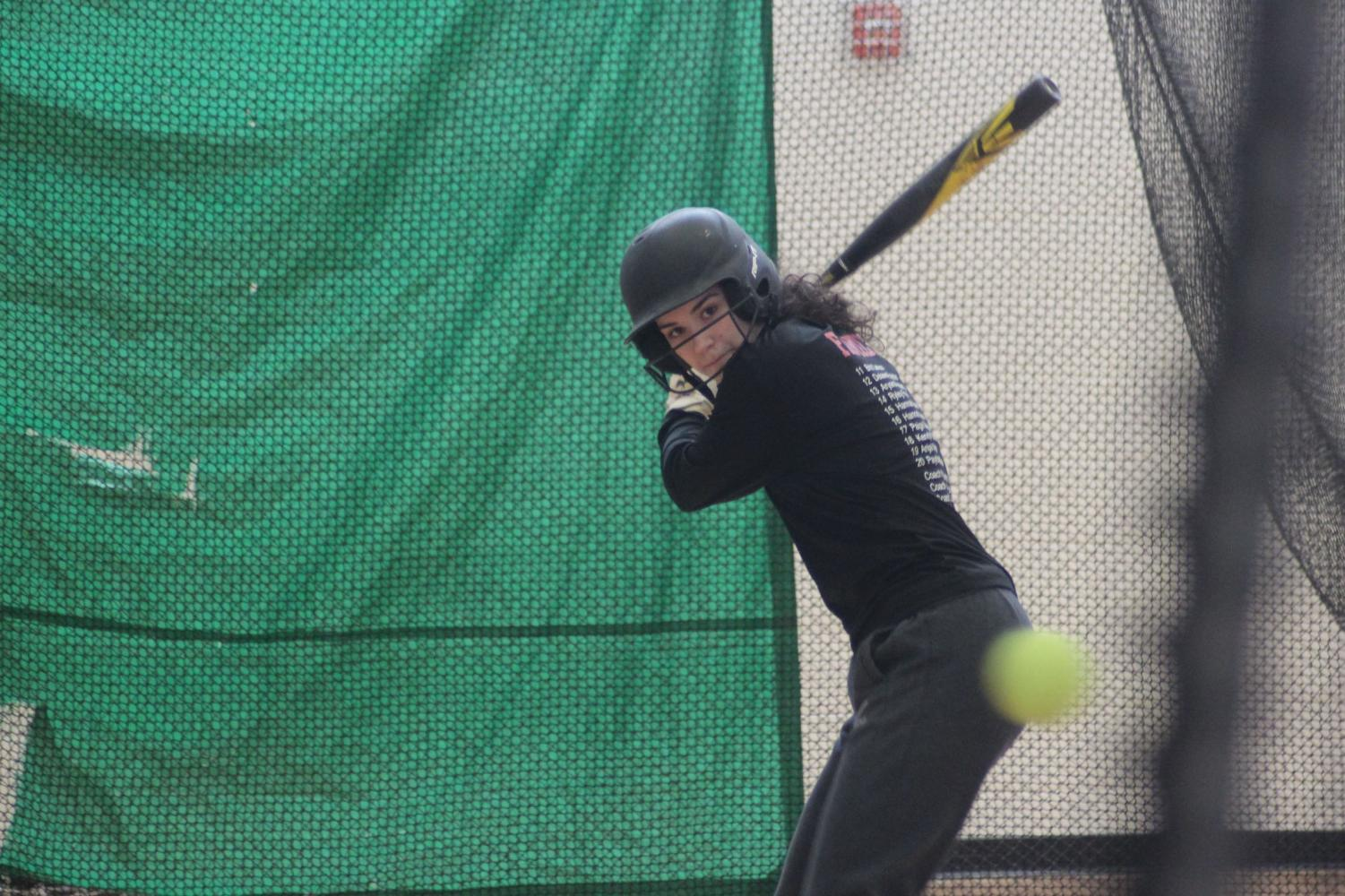 Sophomore Hannah Howell works on hitting technique during Park softball captains practice Mar. 3rd. Tryouts will begin Mar. 11th after school in the old gym.