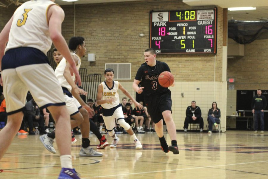 Junior Cole Ewald works his way around the opposing team in hopes of scoring. This was Park's last game before Sections. The game took place March 1 and Park won 55-41. Its next game takes place at 7 p.m. March 8 at Osseo High School against Hopkins.