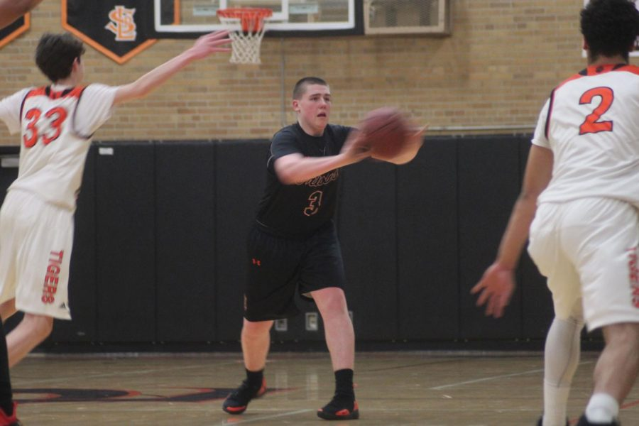 Junior Cole Ewald passes the ball to a teammate during Parks' first Sections game against Minneapolis South March 5. Park won the game with a score of 87-63.