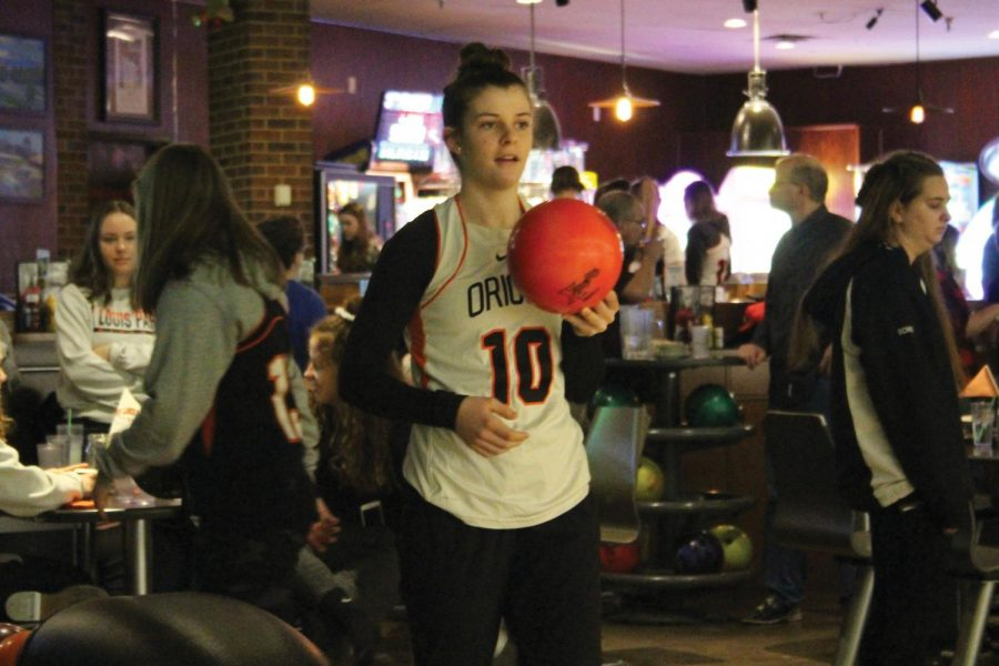 Sophomore Erin Brousseau prepares to bowl during the lacrosse bowling fundraiser March 9.