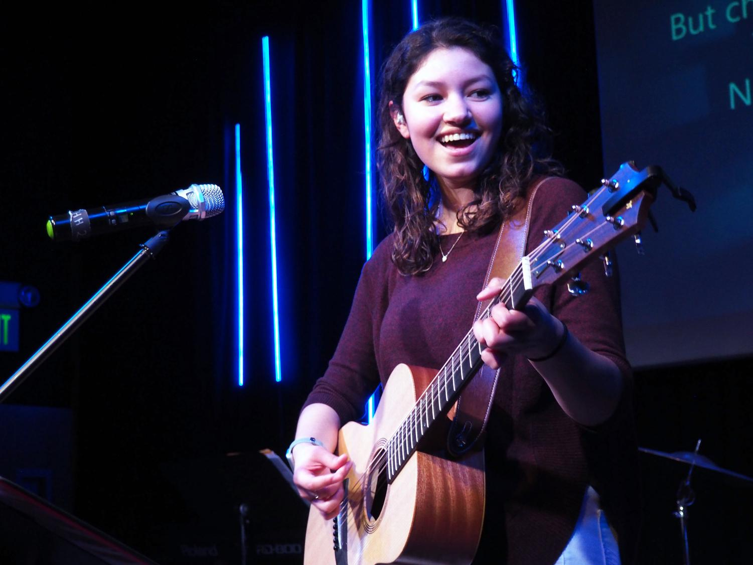 Junior Victoria Contreras plays guitar and sings during worship at Edebrook Church March 20. Contreras performs