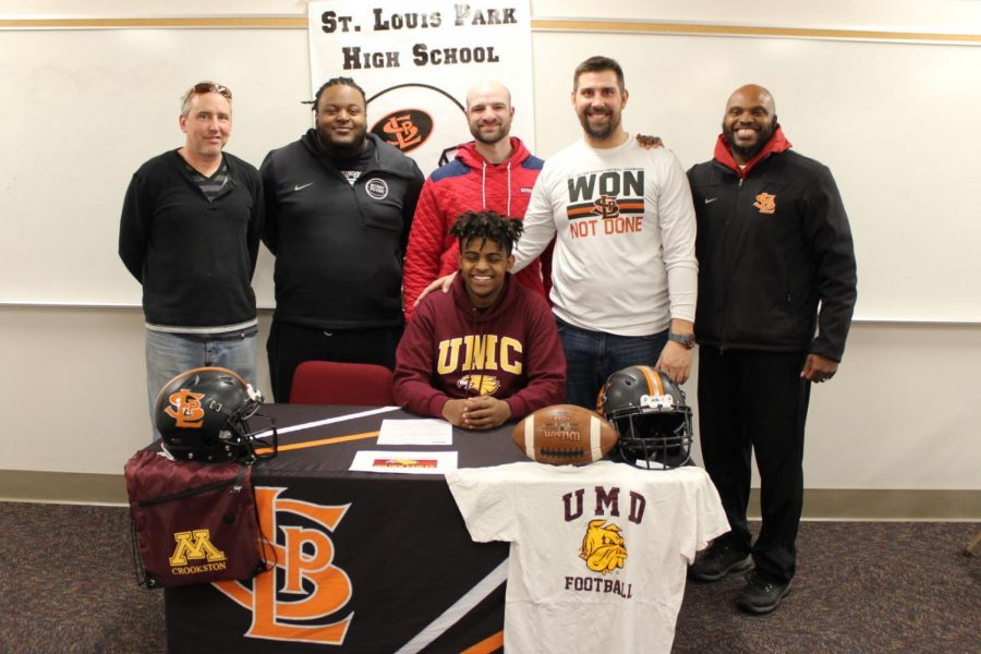 Senior+Milkaso+Dedefo+signs+his+commitment+to+play+football+at+the+University+of+Minnesota+Crookston+on+Feb.+6.+Dedefo+was+accompanied+by+his+teammates%2C+coaches%2C+family+and+friends.