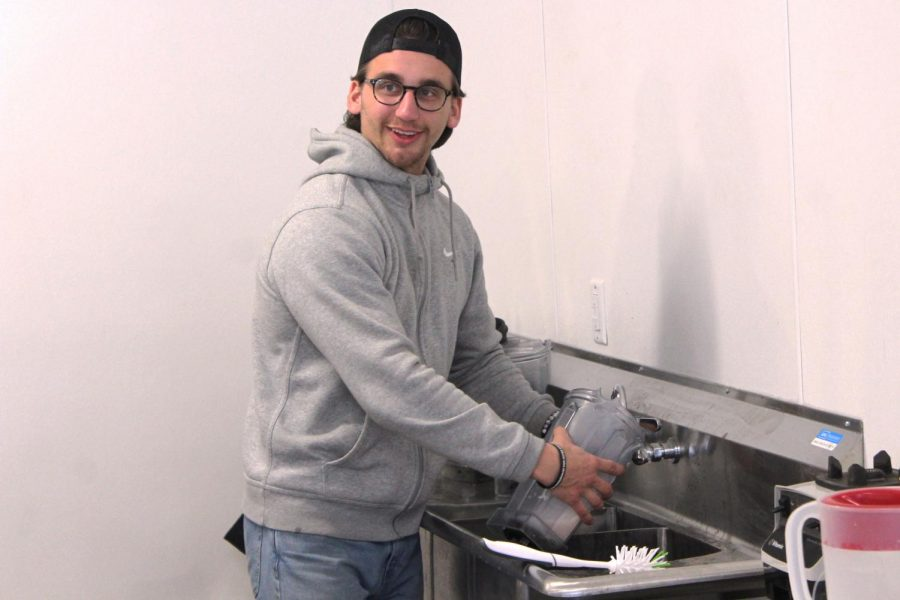 Co-founder of SLP Nutrition Alex Brose washes dishes after preparing shakes for customers. SLP Nutrition is a health club with a mission of creating a healthy community.