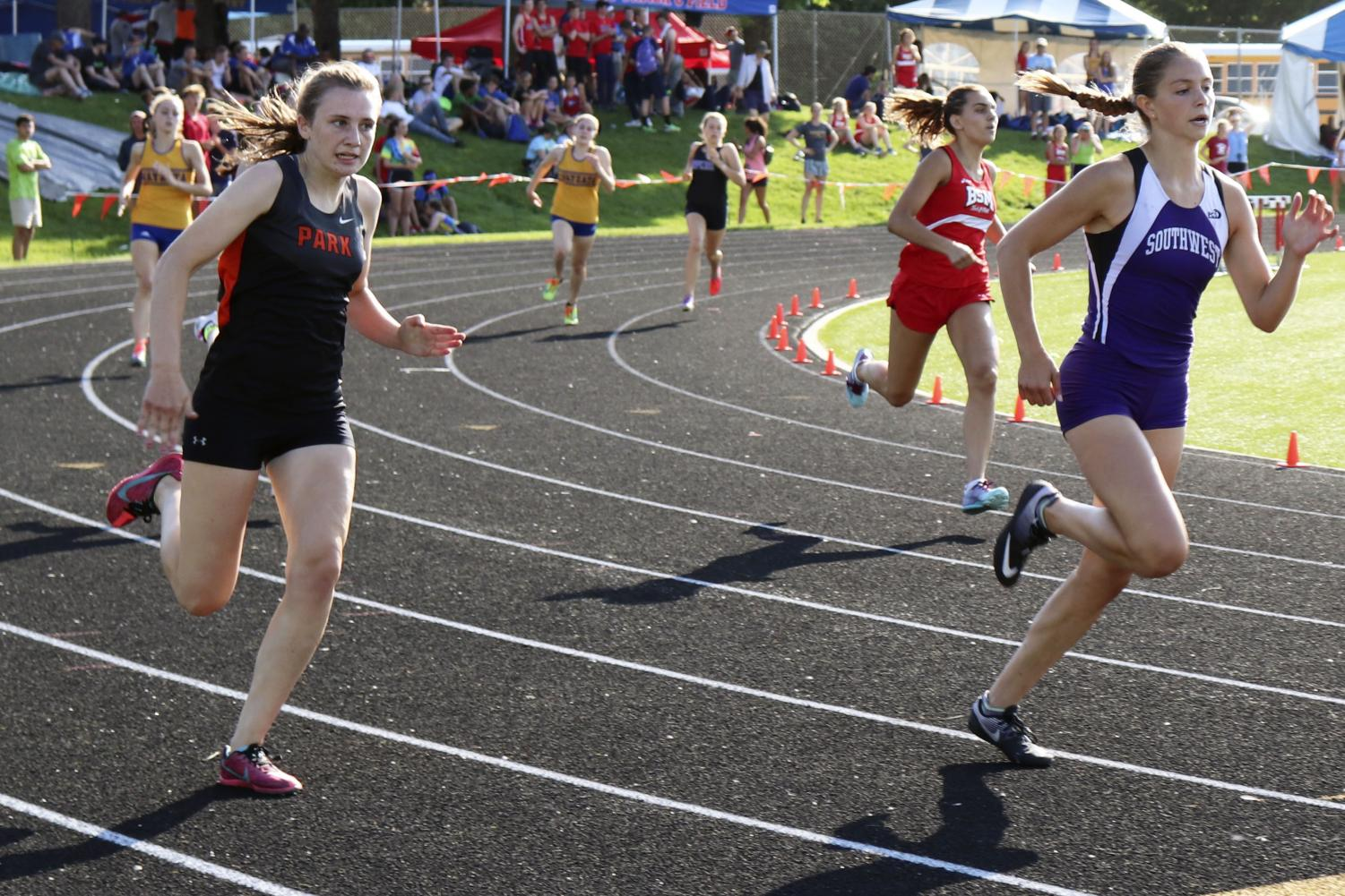 Senior Anna Jenissen races the 200m during the 2018 track and field season.