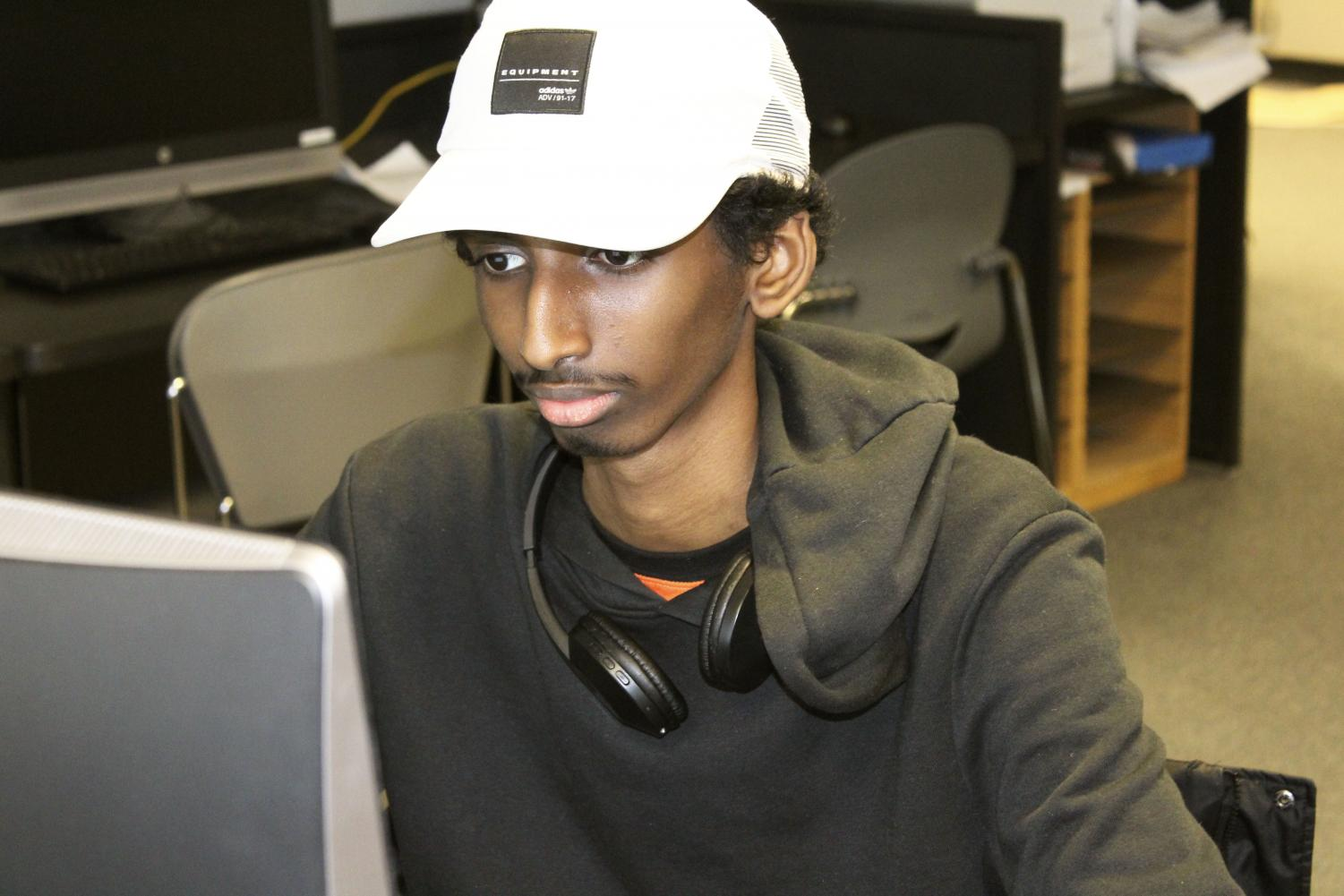 Sophomore Hamsa Osman posts on one of the social media platforms of his business, Sports-Check it out. He created the social media aspect of marketing for Sports-Check it out.