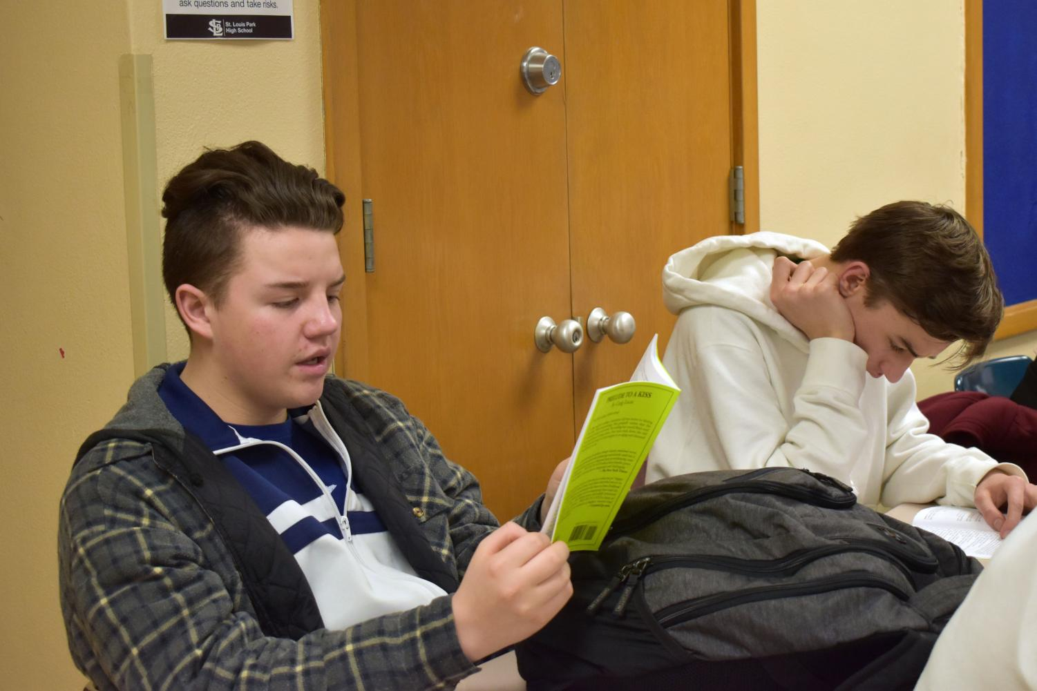 Sophomore Isaac Scott reads his lines aloud during the read through for the spring play March 13. The spring play this year is