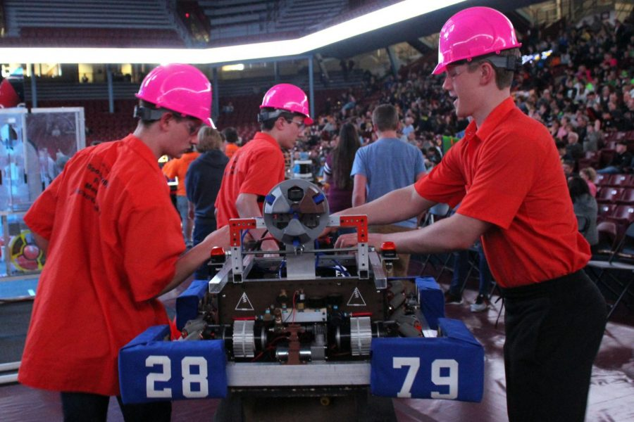 Juniors Jacob Johnson and Will Schwetering prepare final touches on robot while walking onto stage to compete Mar. 29. The tournament lasted March 28-31 and Park placed .