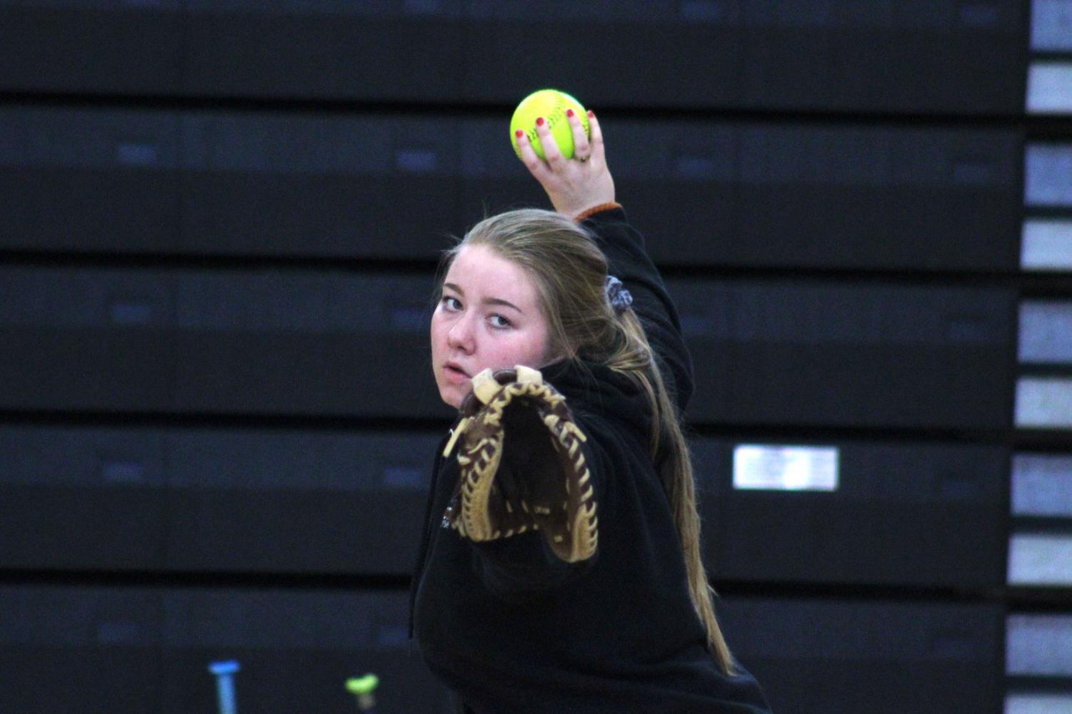 Senior Maddy Schmitz pitches the ball to a teammate during softball tryouts March 13. The teams' first game will be 4:30 p.m. April 9 at New Hope Learning Center against Robbinsdale Cooper.