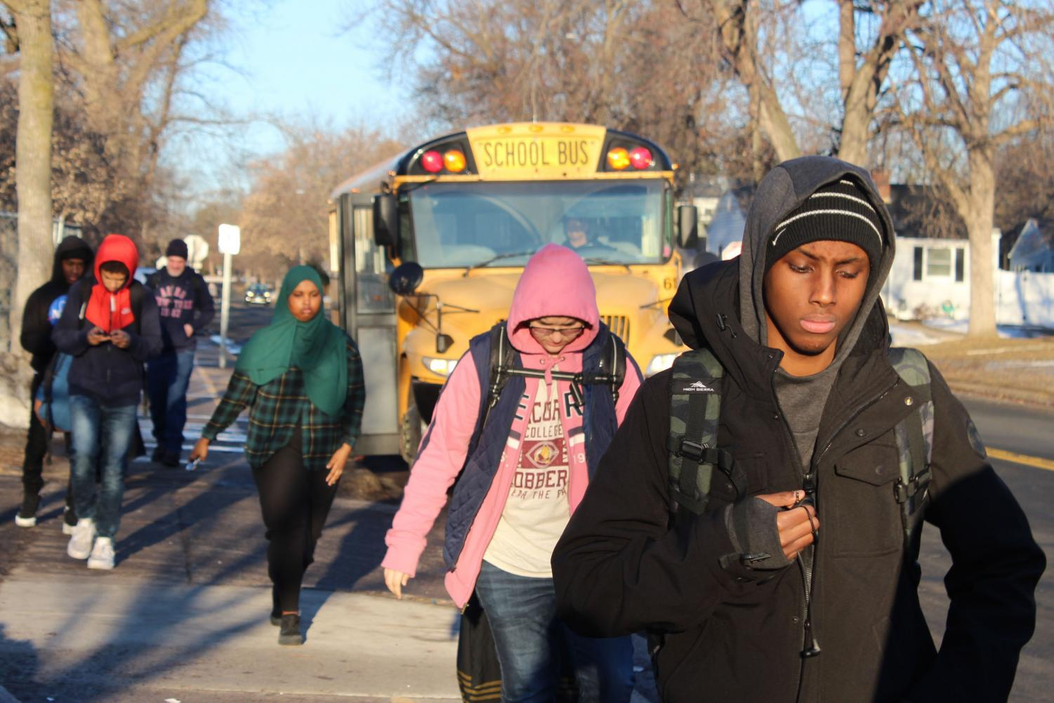Park students walk into school March 22. The school board is currently deciding between two different starting times for all the Park schools.