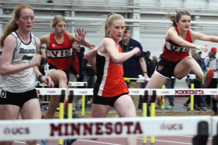 Junior Anna Keith recovers after jumping over a hurdle and prepares for the next. Park participated in a preseason invitational on March 30 at the University of Minnesota.
