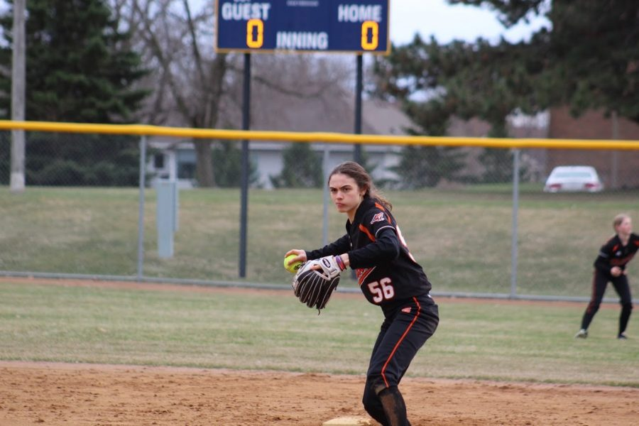 Junior Caitlin Seaman focuses on throwing the ball to her teammate. Park softball is currently eighth in the Metro West conference.