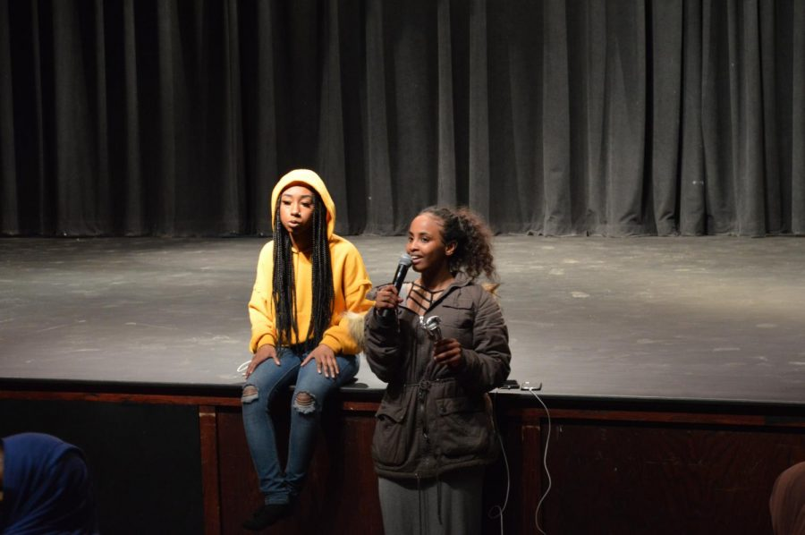 Junior multicultural show leader Zahra Mohamed and senior Sabriyyah Bilal speak to participants during Multicultural Show practice March 28. According to Mohamed, the event will be held April 12.