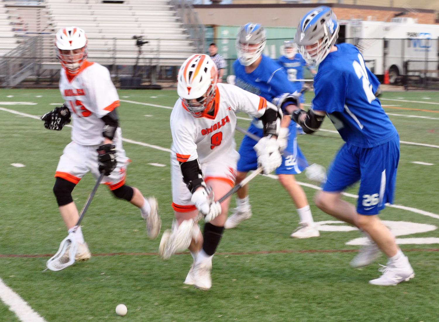 Junior Flynn Spano looks to recover the ball and avoid Hopkins attackers. After allowing four goals in the first quarter, Park allowed five more goals, and scored three, over the next three periods. The final score of the game was 4-9 Hopkins.