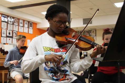 Junior Hilda Habia bows up her violin during class April 10. Practices are in preparation for orchestra's upcoming performance April 18.