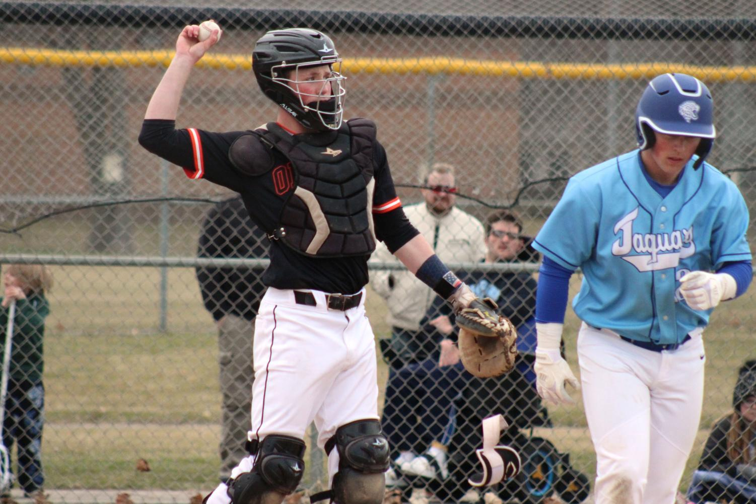 Sophomore Sam Hunt throws baseball back to the pitcher. Park Baseball won the game against Bloomington Jefferson 1-0.