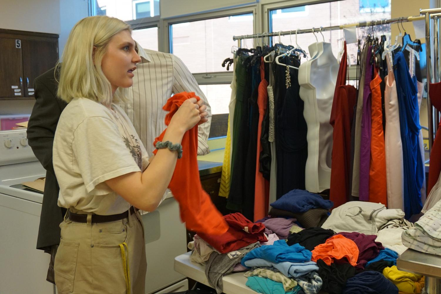 Senior Ava Townsend folds clothing in order to get The Clothing Closet ready for students. The Clothing Closet is open Tuesday through Thursday during third hour for any students looking for free secondhand clothing.