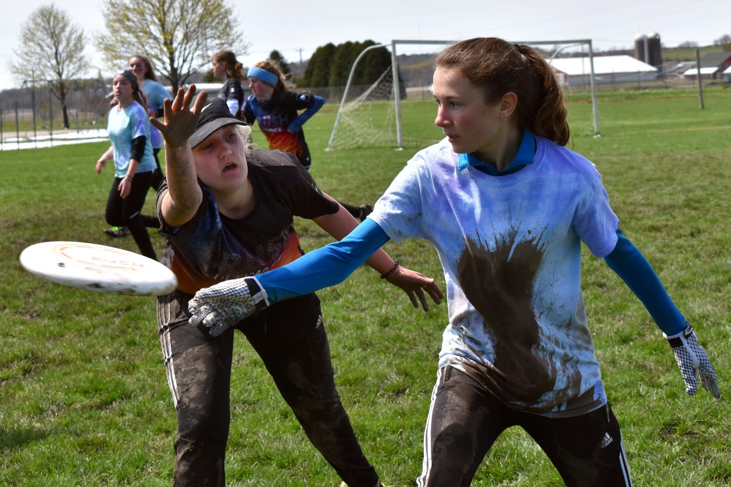 Junior Amelia Ryan attempts to defend the disc during the last game of the Madison Mudbath Tournament April 28. The next tournament will be the Hopkins Hustle Tournament May 11-12.