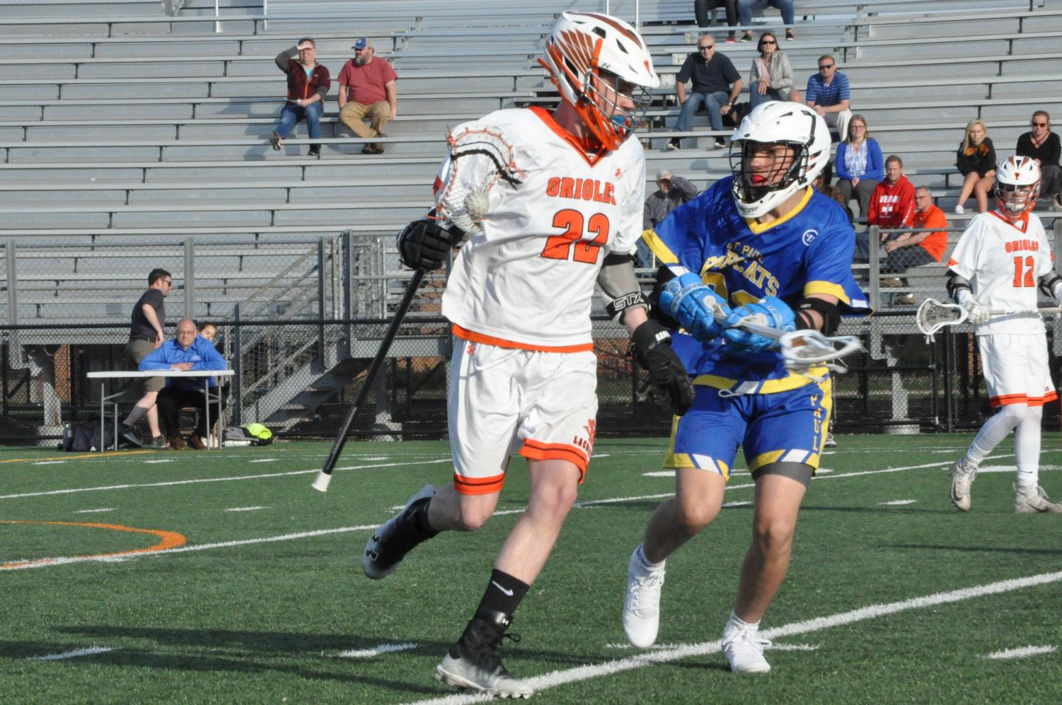 Sophomore Will Schoenecker twirls his stick in order to maintain possession. The game occurred at 5 p.m. April 25 at the St. Louis Park stadium.