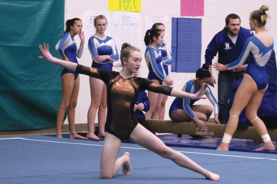Eighth+grader+Sophie+Earle+performs+her+floor+routine+at+a+meet+against+Hopkins.+The+middle+school+will+now+be+getting+out+3%3A52+p.m.%2C+which+will+affect+sports+practices+and+after-school+events.+