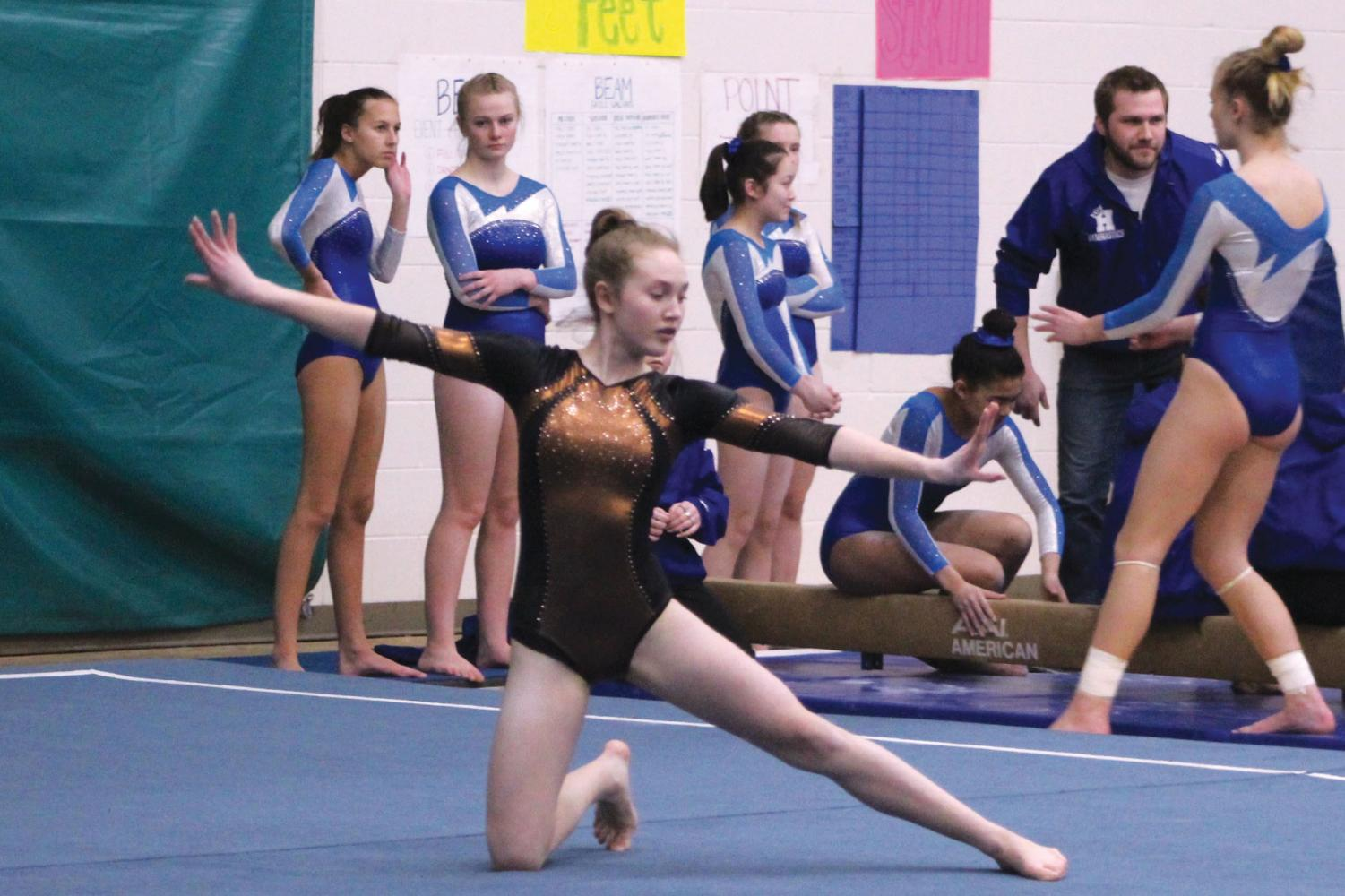 Eighth grader Sophie Earle performs her floor routine at a meet against Hopkins. The middle school will now be getting out 3:52 p.m., which will affect sports practices and after-school events.