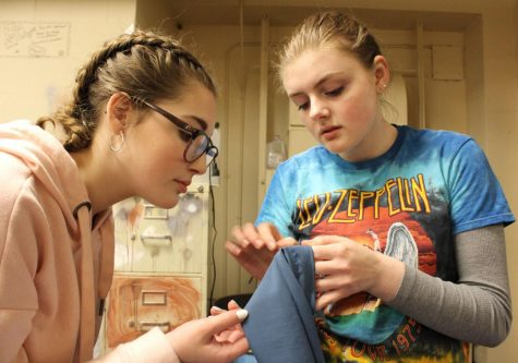 Junior Morgan Graves helps sophomore Ainsley Preston Pepperell sew a costume for 'The Amish Project.' Graves exercises her sewing skills by helping create costumes for the school productions, as well as teaching others how to successfully create costumes through sewing.