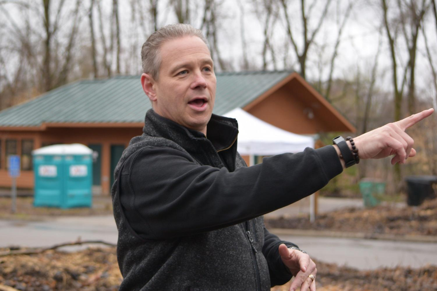 St. Louis Park Recreation superintendent Jason West points out features of the future interpretive center to community members at the groundbreaking ceremony April 22. Construction will begin in May 2019.