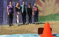 Roots and Shoots paints wall for Earth Day