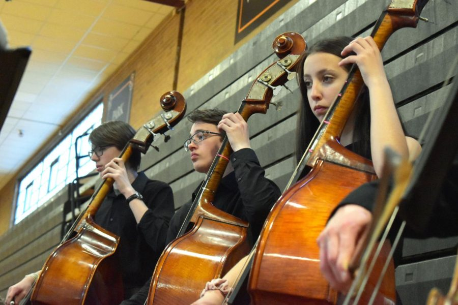 Freshmen Mathea Bruns and Thomas Hanson play the bass at the orchestra concert April 18. The next orchestra concert will be the spring concert held May 30.