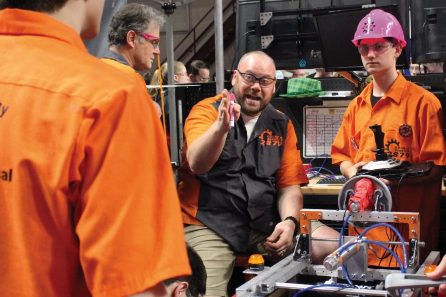 Robotics coach Trevor Paulson strategizes with junior Will Schwietering for next game in the first Robotics competition tournament March 29. Orioles Robotics placed 56 out of 63 in the tournament overall, according to First Robotics.