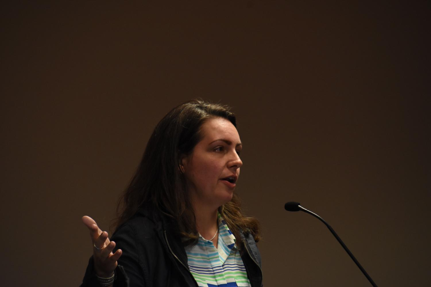 Parent Sarah Mutchler speaks at the School Board meeting March 25 during open forum. Mutchler said before a final vote, the questions from the community should be answered.