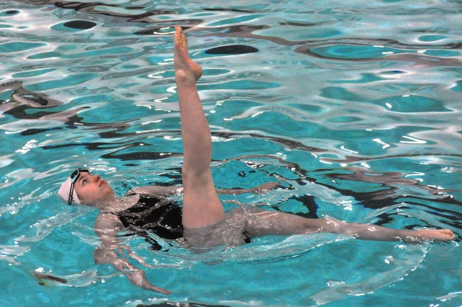 Junior Ava Tronson performs her ballet leg in front of a panel of judges at a figure meet March 21.