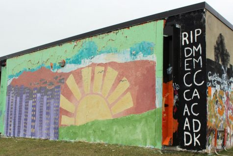 Roots and Shoots painted the wall April 18. According to Senior Katie Christiansen, the wall is painted with symbols that represent Minnesota's environmental habits and expectations.