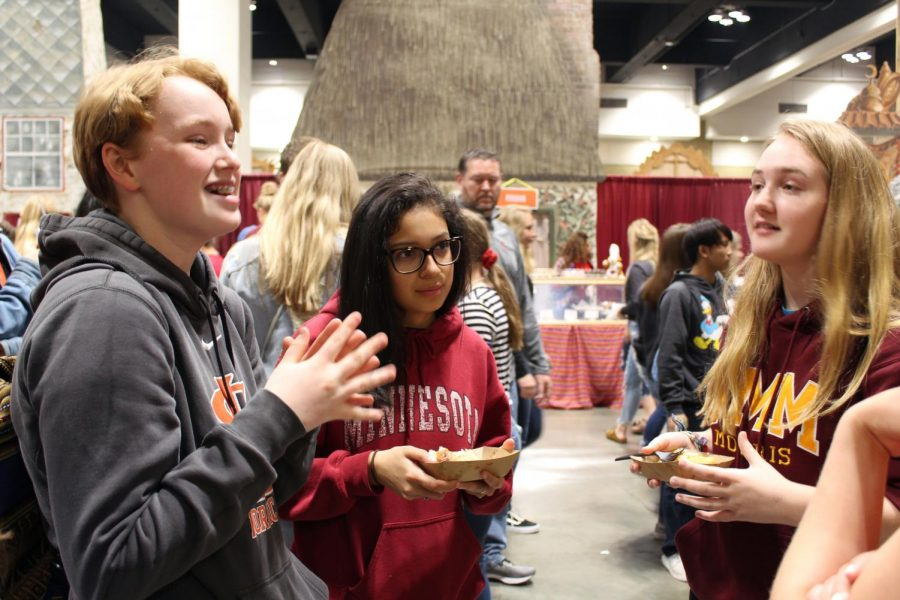 Sophomore Marit Gabel laughs with her friends in the food court. Different countries sold traditional food during the festival.