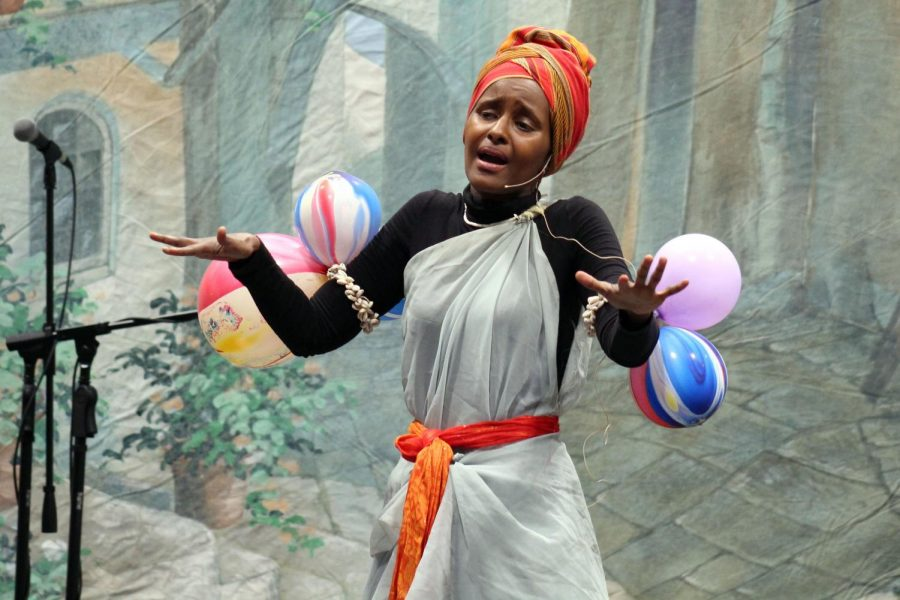 Storyteller Ifrah Mansour performs May 3 at the Festival of Nations. She told a story about the colonial history of Somalia.