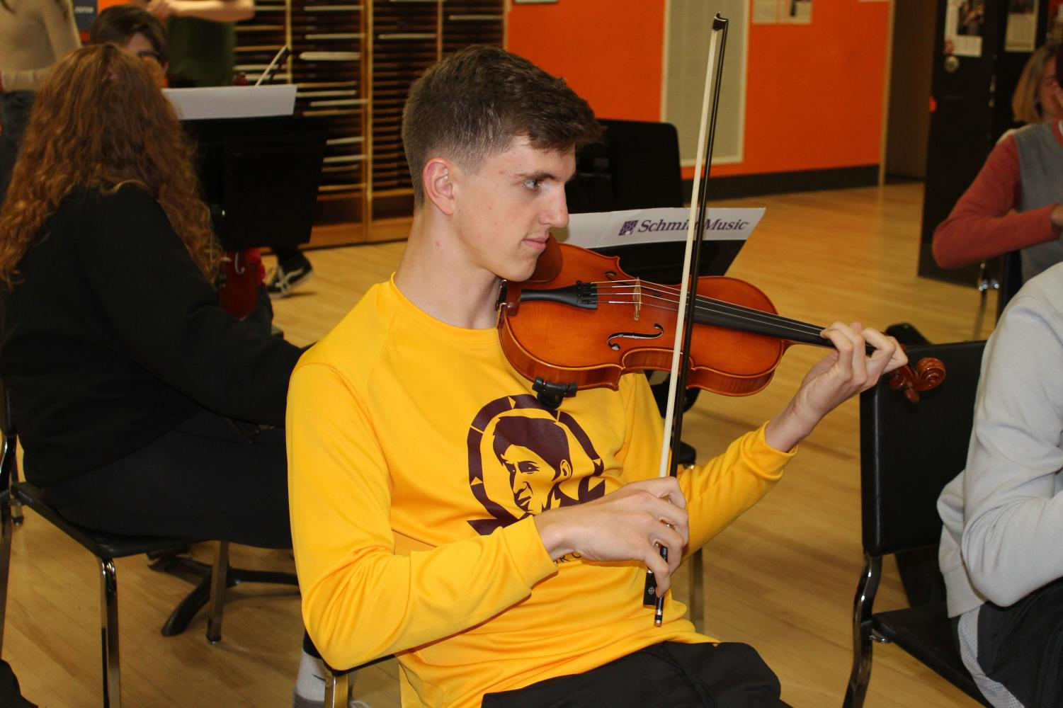 Emmett Foner plays the violin during his orchestra class May 2. Foner was awarded a full ride scholarship to the University of Wisconsin Eau Claire.