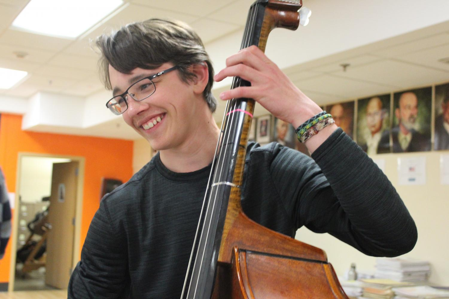 Freshman Thomas Hanson plays bass during orchestra practice May 9. Orchestra is practicing in preparation for its spring concert May 30.