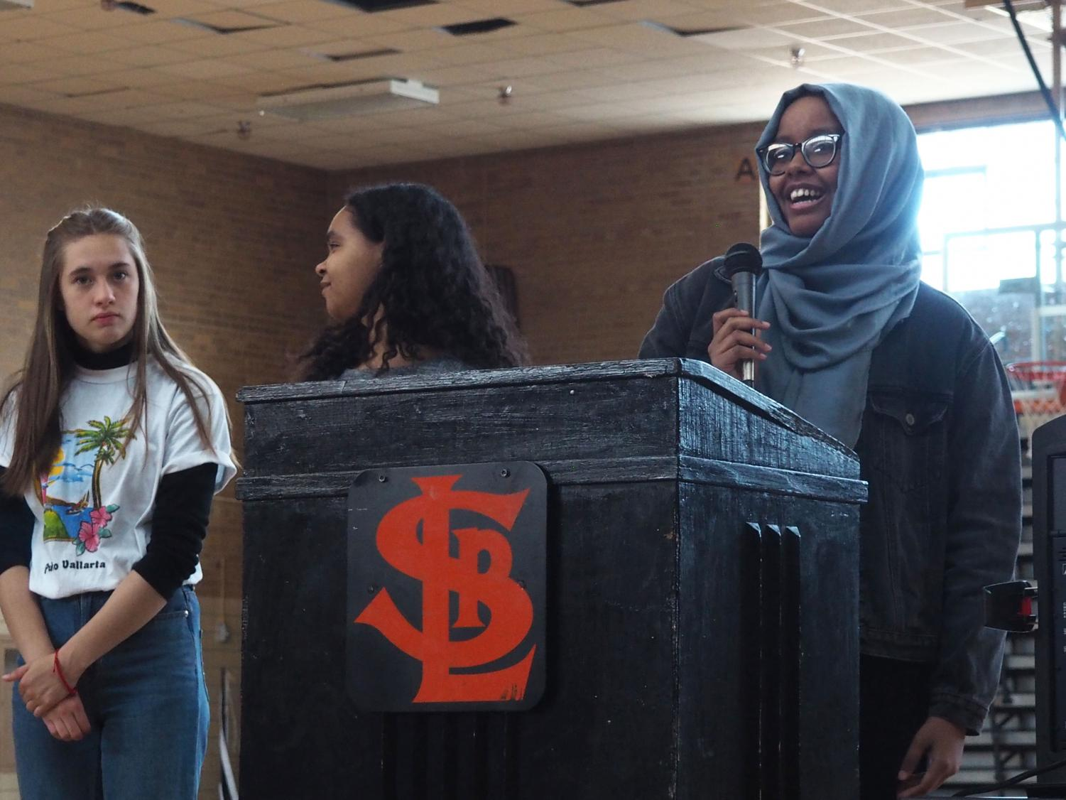 NHS Vice President Senior Marian Mohamud inducts incoming Vice President junior Maggie Klaers at the NHS induction ceremony May 3 in the old gym. NHS inductees' families were invited to the ceremony and breakfast was provided.