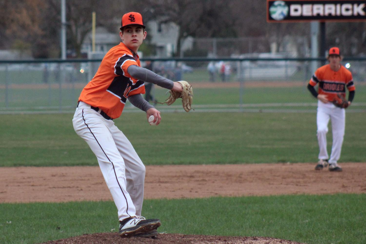 Freshman Kristopher Hokenson pitches against Robbinsdale Cooper. Hokenson broke Dakota Park field records for being the first freshman to pitch a 10-0 game. This was Hokenson's first time pitching for the Park varsity team.