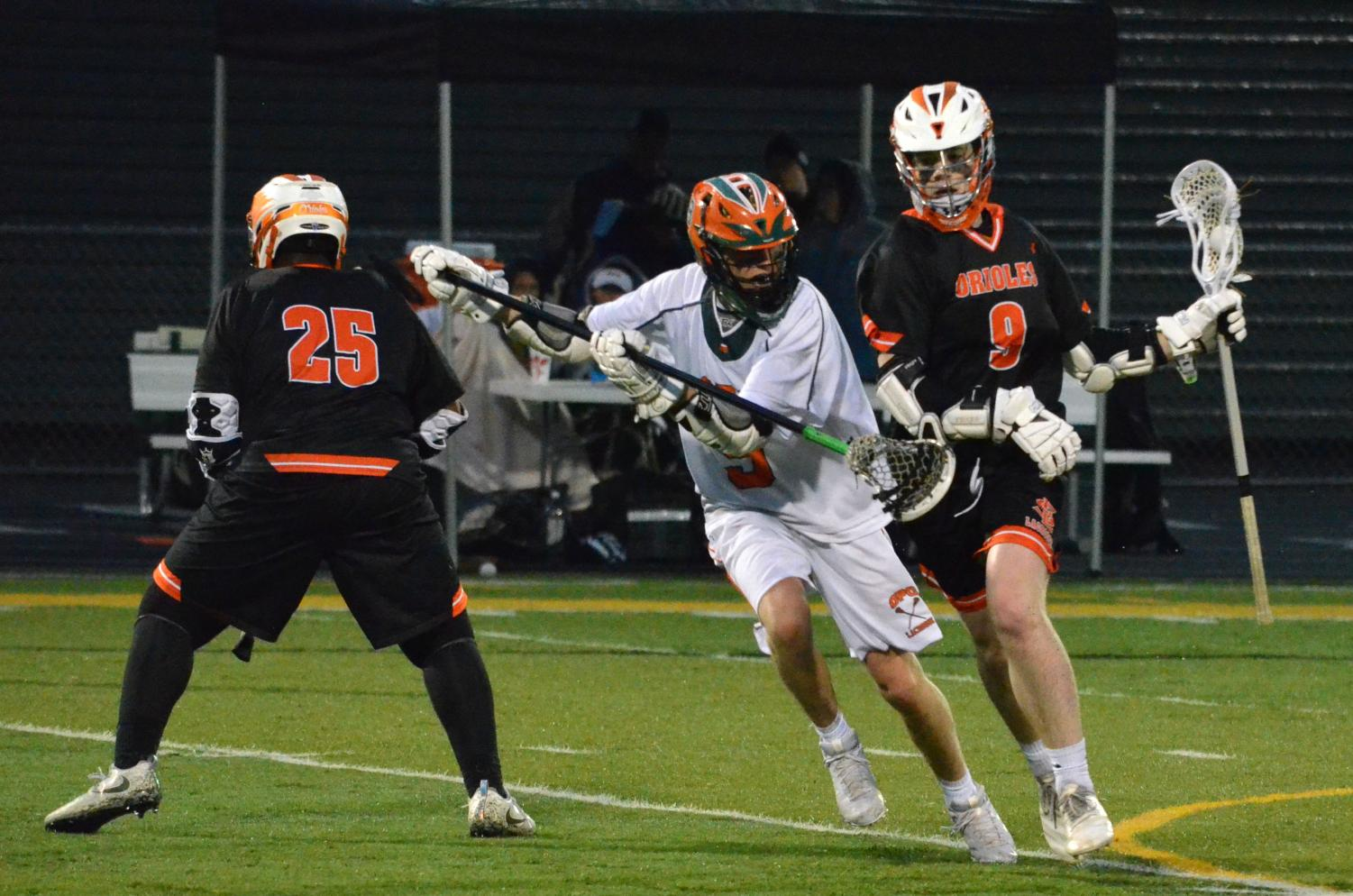 Junior Flynn Spano takes the ball upfield while avoiding a Park Center defender. Park scored its only two goals in the first quarter of the game.