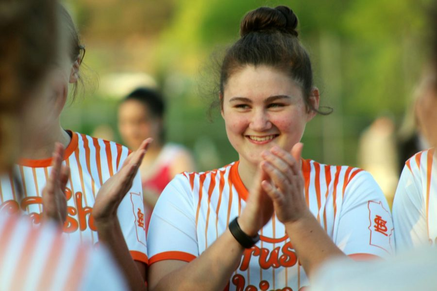 Sophomore Clara Deforge claps for a teammate who was recognized for spirit of the game.