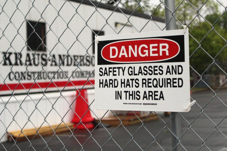 A sign warns for safety protections to be taken by Kaus-Anderson construction workers when entering the construction area. The construction at Park began as a part of the $100.9 million referendum to improve facilities in the district.