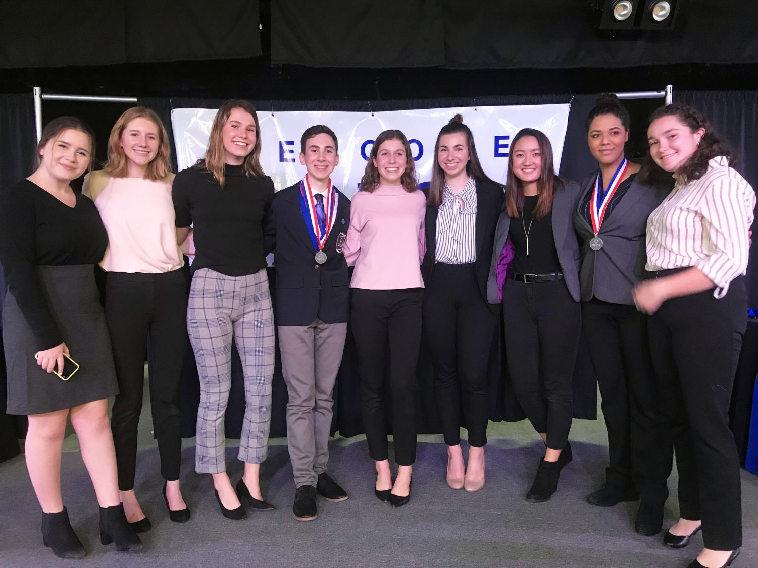 DECA seniors celebrate their last district awards on Jan. 28. Seven of the seniors advanced to State on March 3-5.