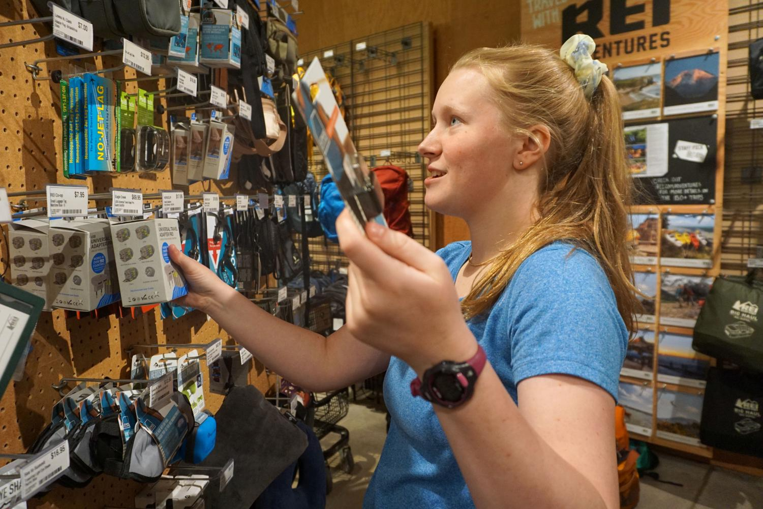 Junior Ellen Poulter shops for supplies at REI for her upcoming hiking trip May 21. Poulter will be hiking the Camino de Santiago in Spain by herself this summer over the course of six weeks.