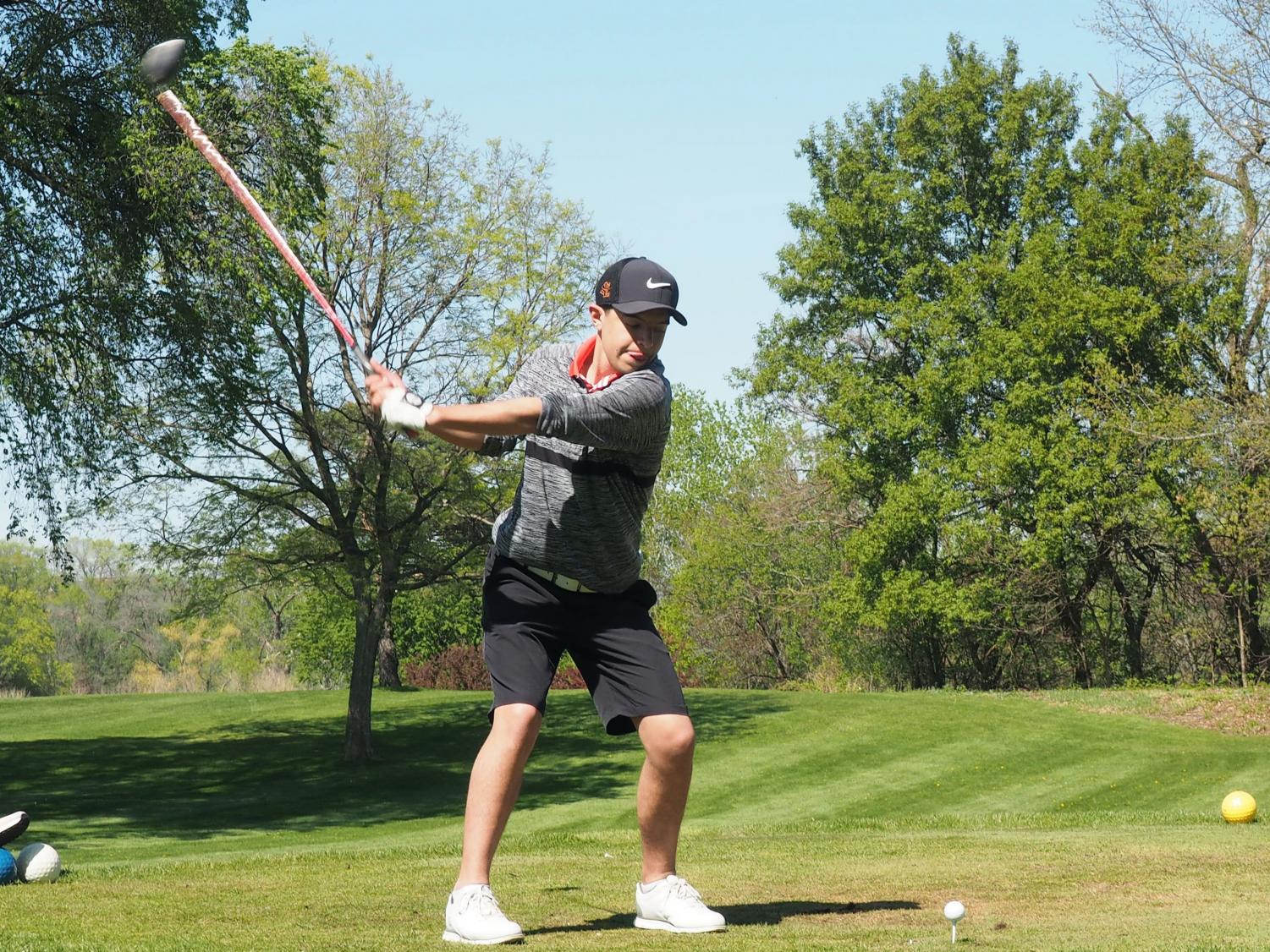 Senior Owen Goddard winds up for a swing at the second hole during a match against Minneapolis Southwest May 15. The next match will be at the Minneapolis Golf Club May 19.
