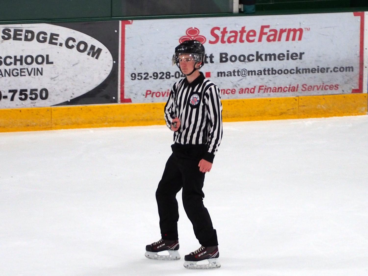 Sophomore Elliot Salmon looks to make a call while reffing a Stars & Stripes game at Braemar Arena in Edina. Stars & Stripes is an AAA hockey tournament for top youth players of every age.