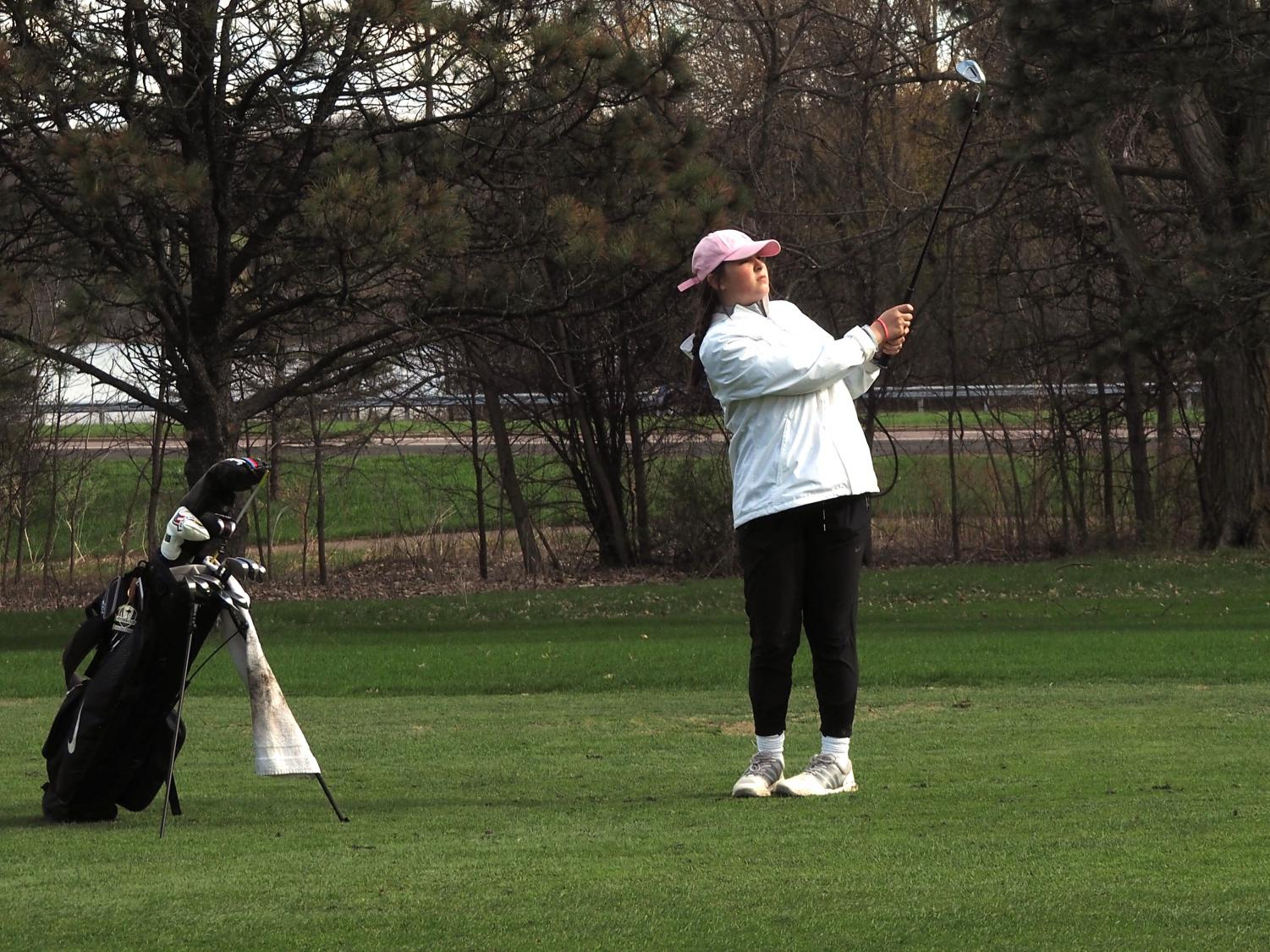 Sophomore Izzy Segal watches her ball after she hits it May 2 at Theodore Wirth Golf Course. Segal was the only girls' golf player to make Sections this year.