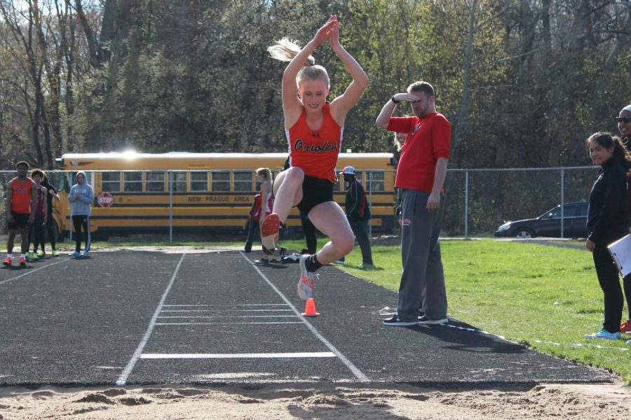 Junior Anna Keith looks to land in the triple jump. Keith placed third behind the schools Wilmar and New Prague.