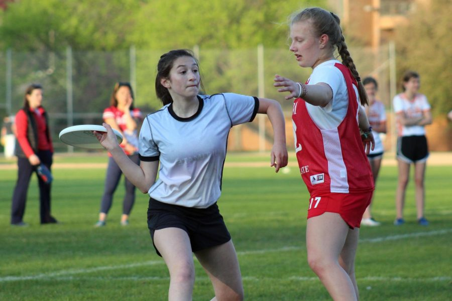 Freshman Gigi Stillman looks to pass the disc to a teammate during the game May 14. Stillman plays the position of handler.